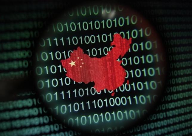 A map of China is seen through a magnifying glass on a computer screen showing binary digits in Singapore in this January 2, 2014 photo illustration.  REUTERS/Edgar Su/Files