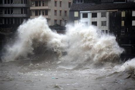 A strong wave breaks along the shore ahead of the landfall of Typhoon Chan-Hom in Wenling in eastern China's Zhejiang province Friday July 10, 2015. AP