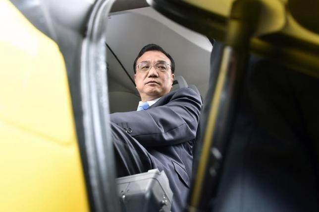 Chinese Prime Minister Li Keqiang sits in a cockpit during a visit to the Airbus A350 assembly plant on July 2, 2015, in Colomiers near Toulouse, ending Keqiang's three-day visit to France REUTERS/Pascal Pavani/Pool