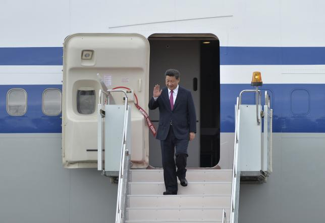 Chinese President Xi Jinping waves upon his arrival before attending the Shanghai Cooperation Organization (SCO) and the BRICS summits in Ufa, Russia, July 8, 2015. REUTERS/BRICS Photohost/RIA Novosti