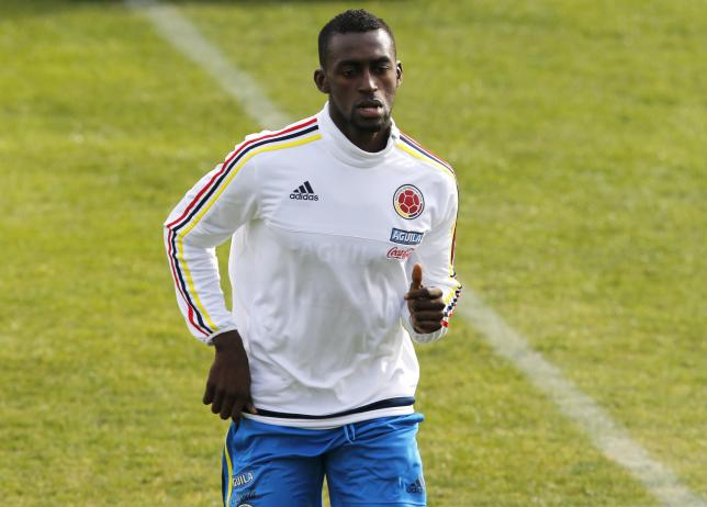 Colombiia's player Jackson Martinez runs during a training session in Santiago, June 19, 2015. REUTERS/Henry Romero