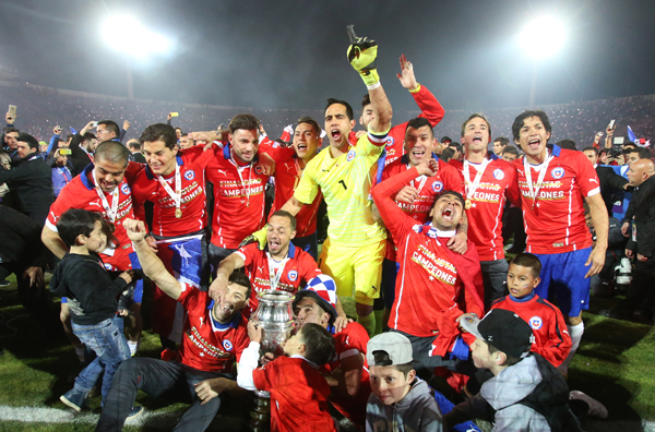 Chile players celebrate with the Copa America trophy after beating Argentina at the National Stadium in Santiago on Saturday. Photo: AP