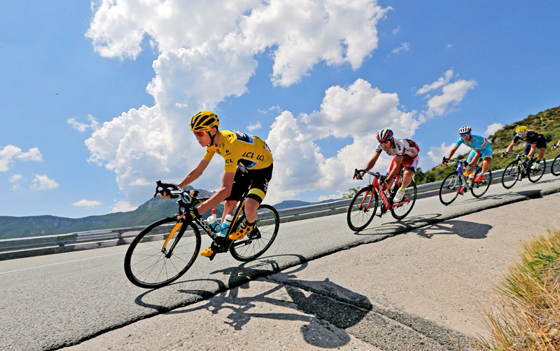 Britain's Chris Froome (left) is followed by Spain's Alberto Losada, Italy's Vincenzo Nibali and Spain's Alejandro Valverde as they speed downhill during the 17th stage of the Tour de France in Pra Loup, on Wednesday. Photo: AP