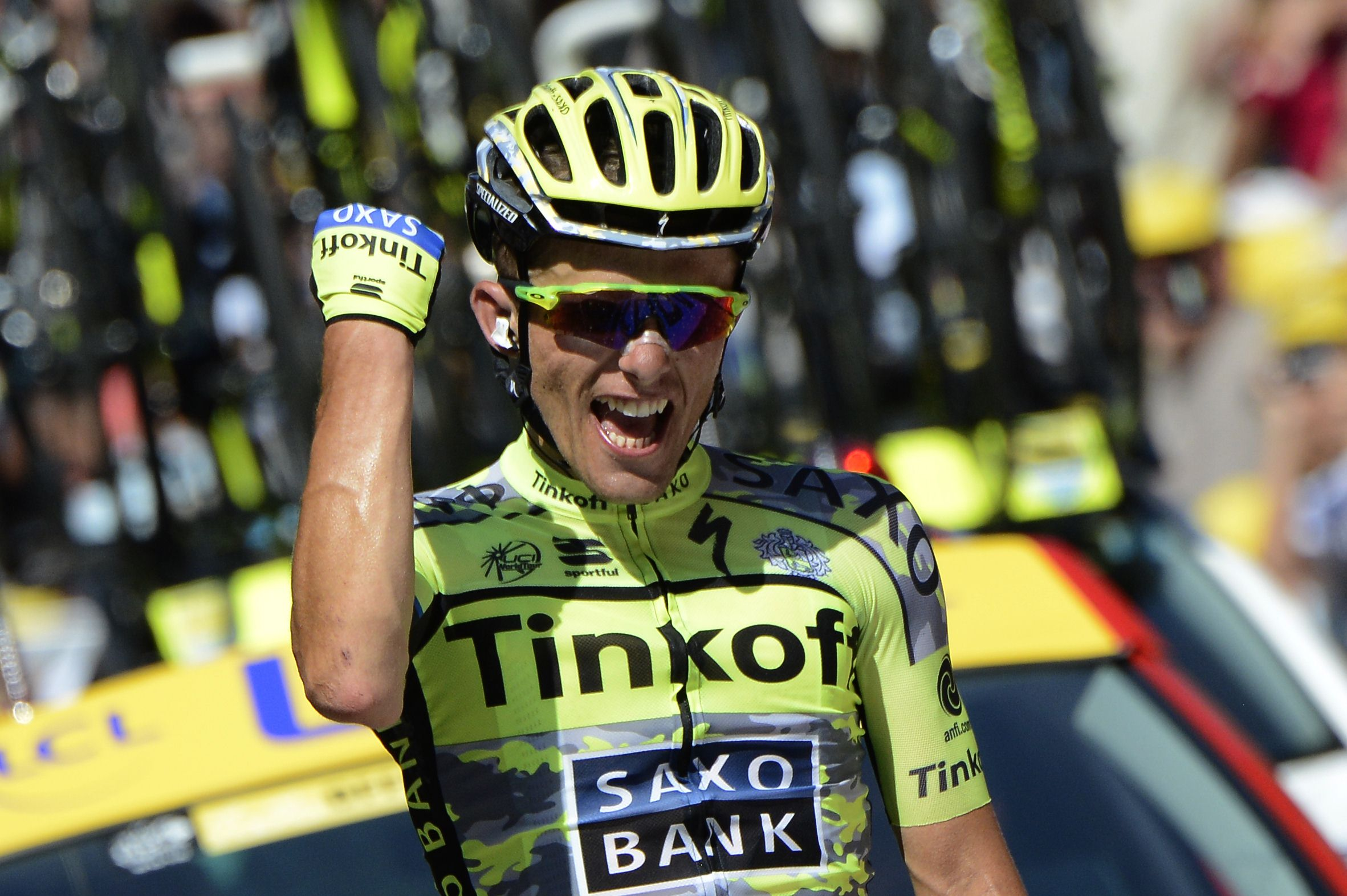 Poland's Rafal Majka celebrates as he crosses the finish line at the end of the 188 km eleventh stage of the 102nd edition of the Tour de France cycling race on July 15, 2015, between Pau and Cauterets, southwestern France.  AFP PHOTO / JEFF PACHOUD