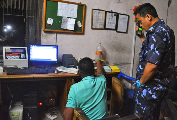 A police team led by DSP Prakash Malla investigating irregularities carried out by Dharmakanta, in Dhading, on Saturday night. Photo:THT