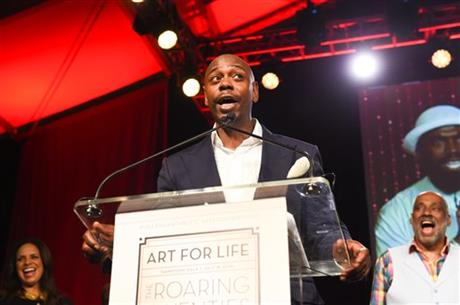 Comedian Dave Chappelle speaks at the RUSH Philanthropic Arts Foundationu2019s Art for Life Benefit at Fairview Farms in Water Mill on Saturday, July 18, 2015, in New York. AP