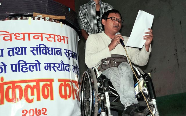 Differently-abled, Hem Bahadur Gurung, presenting his views on the preliminary draft of the constitution in a programme organised to collect public feedback, in Pokhara on Monday, July 20, 2015.