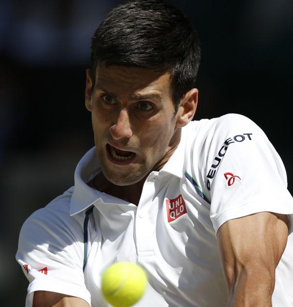 Serbiau0092s Novak Djokovic returns to Franceu0092s Richard Gasquet during their Wimbledon semi-final match in London on Friday.Photo: AP