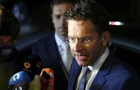 Dutch Finance Minister Jeroen Dijsselbloem speaks with the media as he leaves after a meeting of eurozone finance ministers at the EU Lex building in Brussels on Sunday, July 12, 2015.  AP