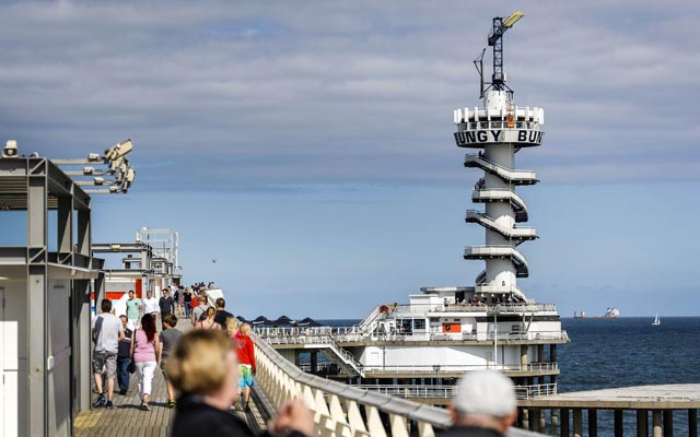 A general picture of the pier of the Dutch resort town of Scheveningen, near the Hague, on Saturday. The landmark pier was bought by two real-estate firms and has been reopened, after being closed for over a year. Photo: AFP
