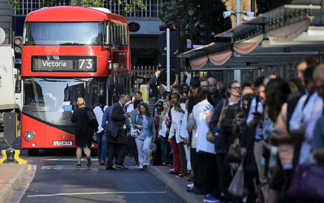 Early morning commuters forming queues to board buses at Victoria station during a tube strike, in London. London's roads, buses and overland trains struggled to cope in Thursday's morning rush hour as commuters struggled to get to work in the face of London Underground's first strike shutdown since 2002. Photo: AFP
