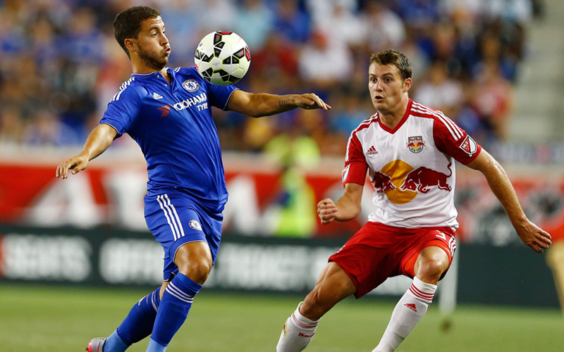 Chelsea's Eden Hazard (left) controls the ball under pressure from New York Red Bulls' Shawn Mclaws during their International Champions Cup match in Harrison on Wednesday. Photo: AP