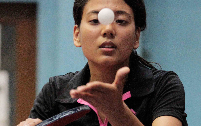 Elina Maharjan of Nepal Police Club serves to Anita Maharjan of Nepal APF Club during their women's singles match at the National Open Table Tennis Tournament in Kathmandu on Thursday. Photo: Udip Singh Chhetry/ THT