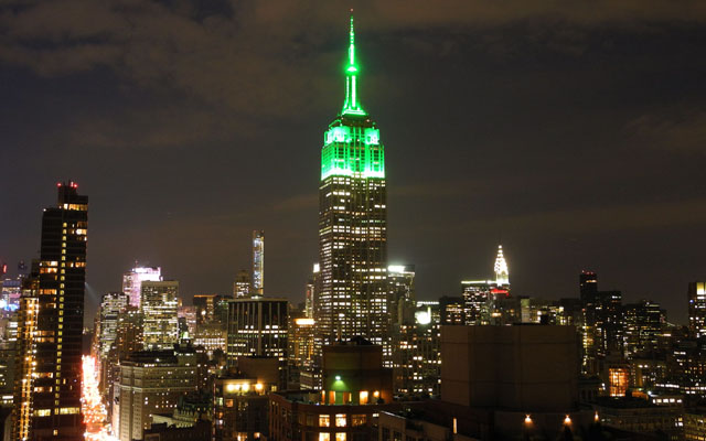 The Empire State Building is lit in green July 17th, 2015 in New York City to celebrate the Eid al-Fitr holiday that marks the end of Ramadan.  The Empire State Building famously shines specific colors for a number of religious holidays -- pastel shades for Easter, blue and white for Hanukkah, and red and green for Christmas. Photo: AFP