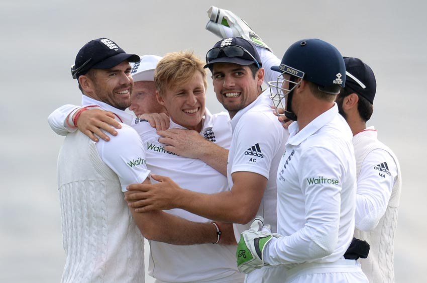 England's Joe Root celebrates with James Anderson and Alastair Cook after dismissing Australia's Mitchell Johnson on July 11. Photo: Reutersnn