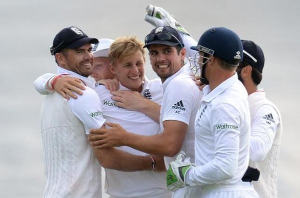 England's Joe Root celebrates with James Anderson and Alastair Cook after dismissing Australia's Mitchell Johnson on July 11. Photo: Reuters