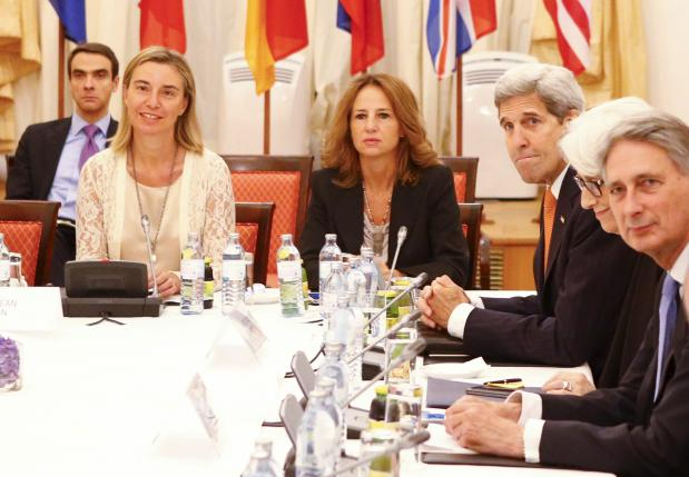 European Union High Representative for Foreign Affairs and Security Policy Federica Mogherini (L), U.S. Secretary of State John Kerry (3rd L), Under Secretary for Political Affairs Wendy Sherman and British Foreign Secretary Philip Hammond (R) wait for the start of a meeting at a hotel in Vienna, Austria July 9, 2015. REUTERS/Leonhard Foeger