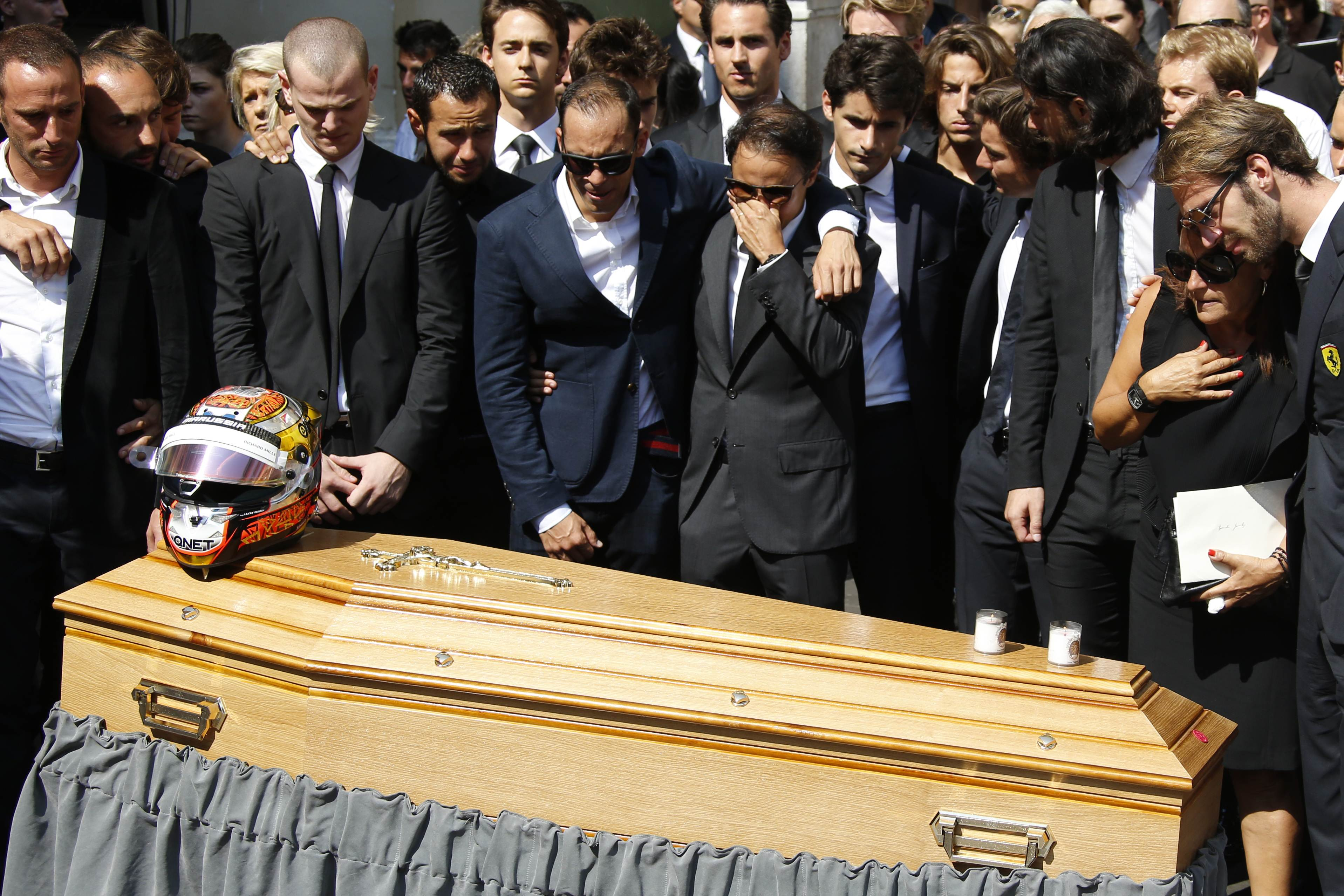 Formula One drivers, friends and relatives stand by Jules Bianchi's coffin after his funeral ceremony in Nice on Tuesday. Photo: AFP