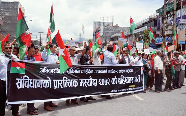 Members of Federal Socialist Forum-Nepal demonstrating, urging public to boybott feedback collection on the constitution draft, outside a programme, organised to collect public opinion's on the preliminary draft of the consitution, in Pokhara on Monday, July 20, 2015.