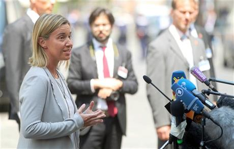 European Union High Representative Federica Mogherini talks to media in front of Palais Coburg where closed-door nuclear talks with Iran take place in Vienna, Austria, Tuesday, July 7, 2015. Mogherini said that negotiations will continue for the next couple of days despite hitting some u201ctenseu201d moments. AP