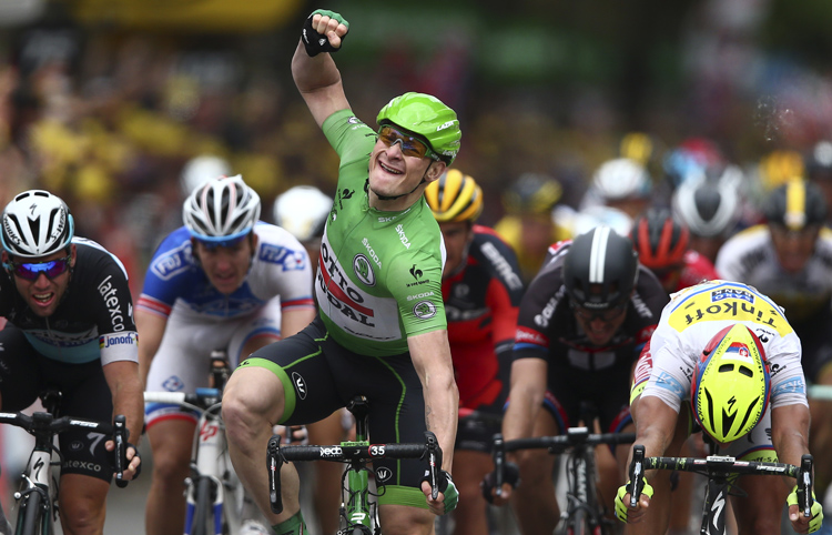 Germany's Andre Greipel celebrates as he crosses the finish line ahead of Britain's Mark Cavendish (left) to win the fifth stage of the Tour de France in Amiens on Wednesday. Photo: AP