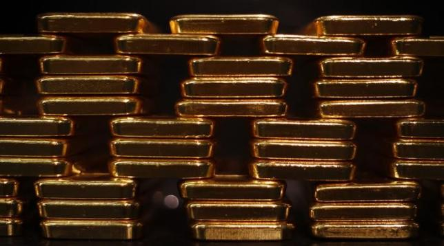 Gold bars are stacked at a safe deposit room of the ProAurum gold house in Munich March 6 2014.    REUTERS/Michael Dalder/Files