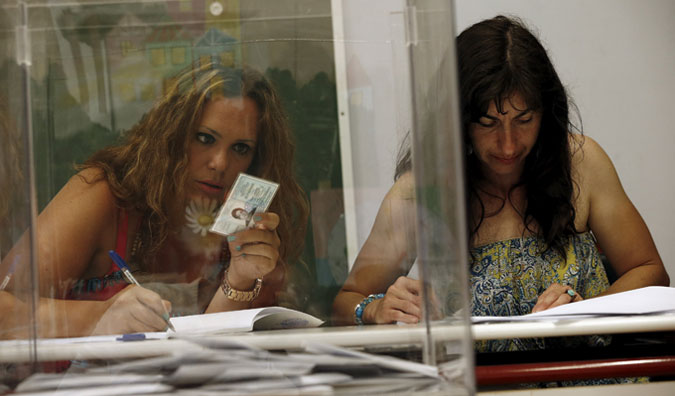 Voting officials check people's identification in the village of Meyisti on the Island of Kastellorizo, which is the most easterly of the islands in Greece, July 5, 2015. Photo: Reuters