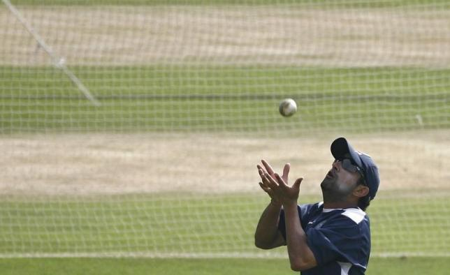 India's Gautam Gambhir catches the ball during a cricket training session in Indore November 16, 2008. REUTERS/Adnan Abidi/Files