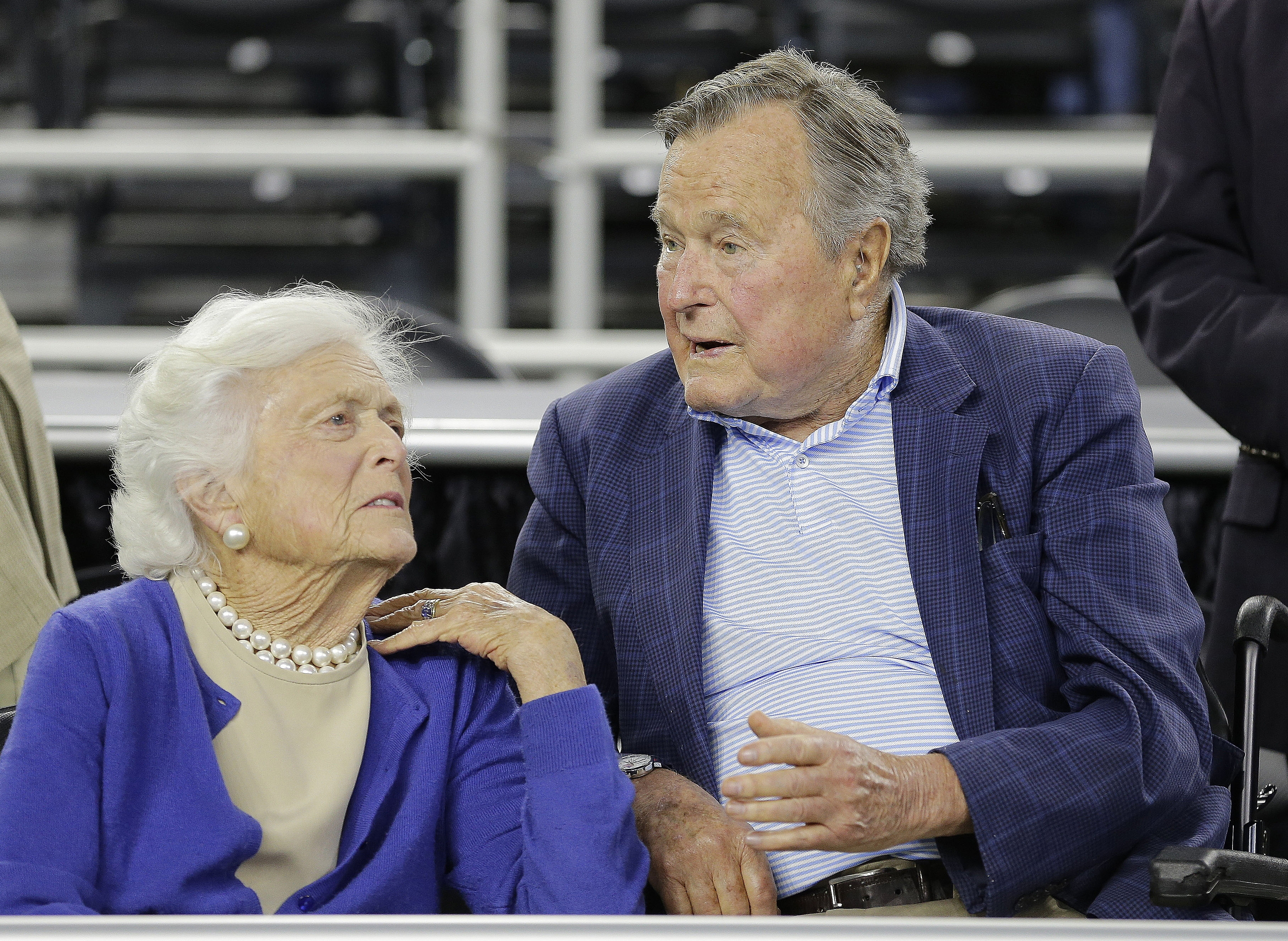 In this March 29, 2015, file photo, former President George H.W. Bush and his wife Barbara Bush, left, speak before a college basketball regional final game between Gonzaga and Duke, in the NCAA basketball tournament in Houston. Bush has fallen at home Wednesday, July 15, 2015, in Kennebunkport, Maine, and broken a bone in his neck. Photo: AP