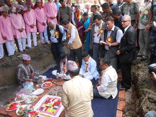Prime Minister Sushil Koirala along with leaders of the four major parties jointly laying the foundation stone of late Girija Prasad Koirala Memorial Building, in Bhadrapur, Jhapa, on Monday. Photo: THT