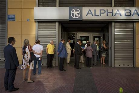 People line up to withdraw cash from a bank machine in central Athens, Wednesday, July 8, 2015. Frustrated and angry eurozone leaders fearing for the future of their common currency gave the Greek Prime Minister Alexis Tsipras a last-minute chance Tuesday to finally come up with a viable proposal on how to save his country from financial ruin. AP
