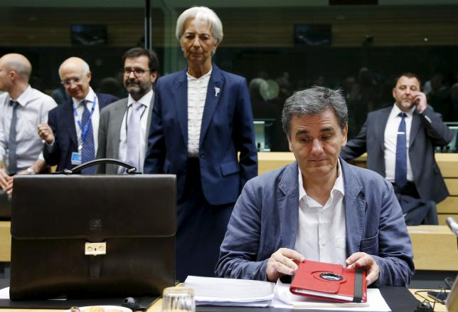 Greek Finance Minister Euclid Tsakalotos and International Monetary Fund (IMF) Managing Director Christine Lagarde (back C) attend an euro zone finance ministers meeting in Brussels, Belgium, July 12, 2015.  REUTERS/Francois Lenoir