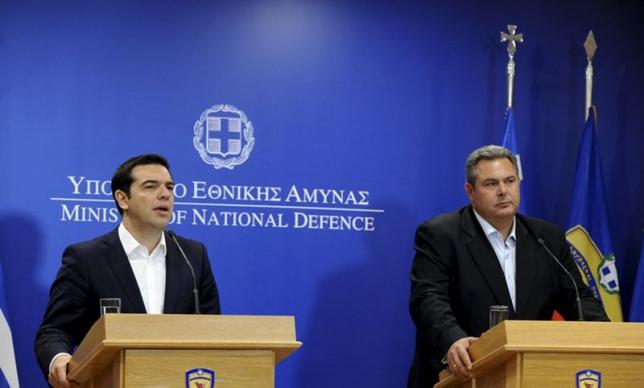 Greek Prime Minister Alexis Tsipras speaks during a news conference as Defence Minister Panos Kammenos (R) looks on in this handout photo released by the Greek Defence Ministry in Athens, Greece July 2, 2015. . REUTERS/Greek Defence Ministry/Handout via Reuters