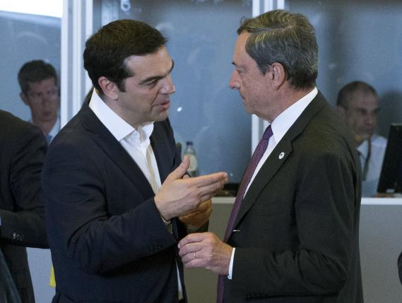 Greek Prime Minister Alexis Tsipras (L) talks with European Central Bank President Mario Draghi during a euro zone EU leaders emergency summit on the situation in Greece in Brussels, Belgium, July 7, 2015.  REUTERS/Yves Herman