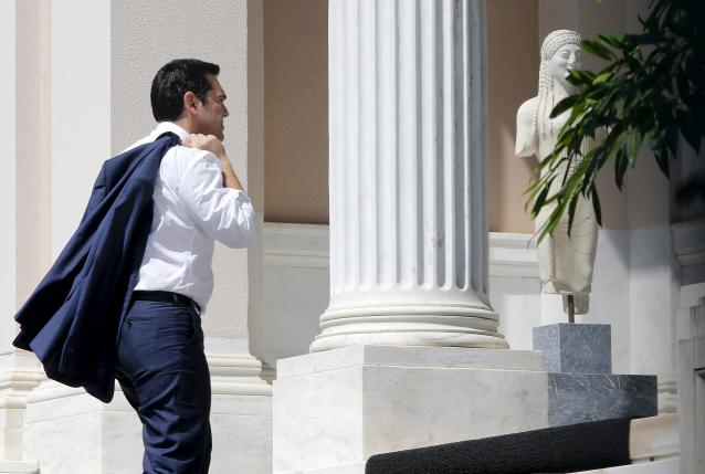 Greek Prime Minister Alexis Tsipras arrives at his office in Maximos Mansion in Athens, Greece, July 13, 2015. REUTERS/Jean-Paul Pelissier