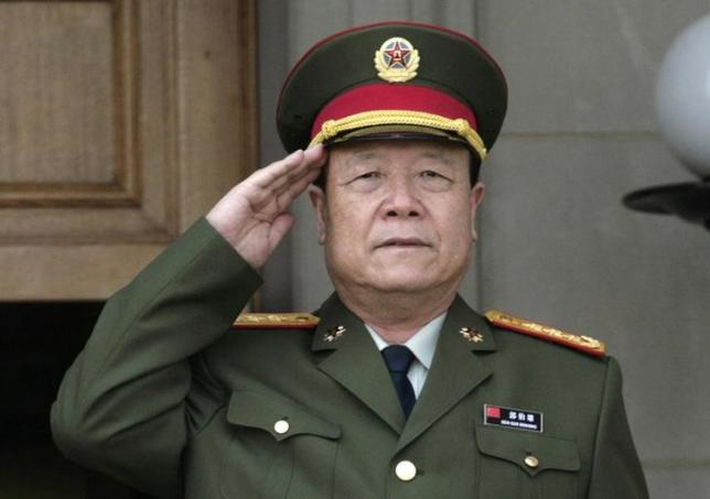 China's Central Military Commission Vice Chairman General Guo Boxiong stands at attention during the playing of the national anthem before a meeting at the Pentagon in Washington July 18, 2006. Photo: Reuters