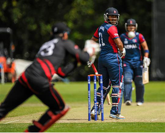 Nepal's Gyanendra Malla watches as he is caught out after his edge carries to Hong Kong's wicket keeper Jamie Atkinson. Photo: ICC/Sportsfile