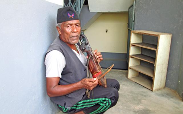 Hari Bahadur Gandarva, 60, singing as he plays the traditional musical instrument sarangi, in Damauli, Tanahun, on Thursday. Gandarva has been preserving the tradition. Photo: THT