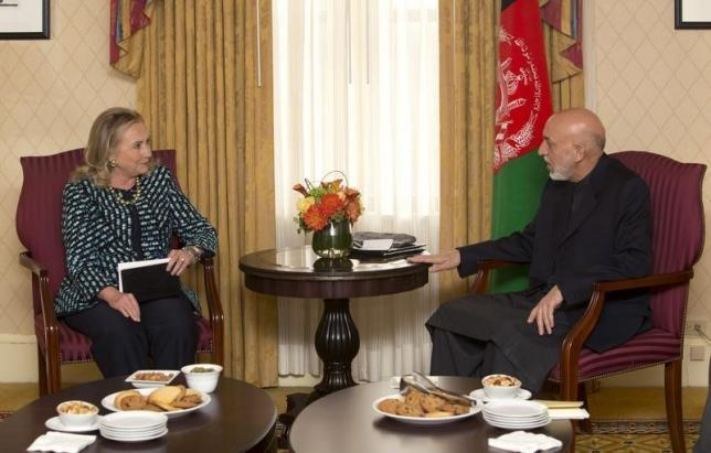 U.S. Secretary of State Hillary Clinton meets with Afghan President Hamid Karzai on the sidelines of the United Nations General Assembly in New York, September 24, 2012.  REUTERS/Andrew Kelly