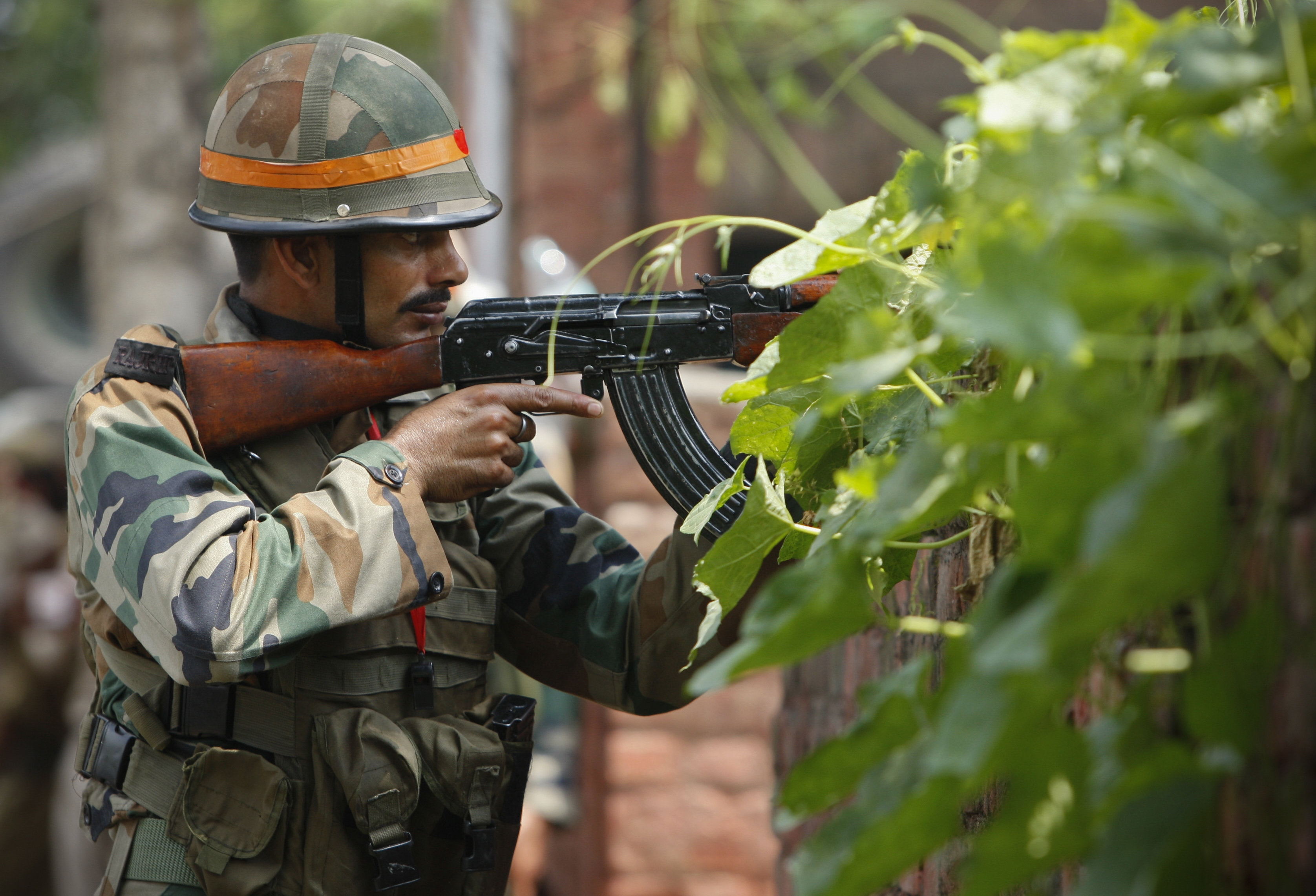 An Indian army soldier holds an AK-47 assault rifle during a fight in the town of Dinanagar, in the northern state of Punjab, India, Monday, July 27, 2015. Indian army commandos joined police in fighting suspected militants who fired at a bus station and stormed into police barracks on the outskirts of a northern town bordering Pakistan early Monday. Rebels have been fighting for an independent Kashmir or its merger with Pakistan since 1989.  Photo: AP