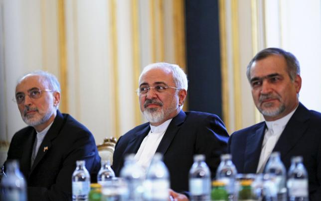 Iranian Foreign Minister Mohammad Javad Zarif (C), Head of the Iranian Atomic Energy Organization Ali Akbar Salehi and Hossein Fereydoon (R), brother and close aide to President Hassan Rouhani meet with U.S. Secretary of State John Kerry (not pictured) at a hotel in Vienna, Austria July 3, 2015.  REUTERS/Carlos Barria