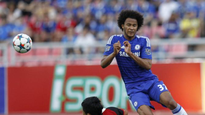 Chelsea's Isaiah Brown, right, vies  for the ball with Thailand All Star Yuthajak Konjan during their friendly soccer match at Rajamangala national stadium in Bangkok, Thailand, Saturday, May 30, 2015. Chelsea beat Thailand All-Stars 1-0. (AP Photo/Sakchai Lalit)