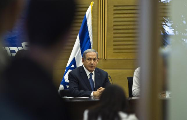 Israel's Prime Minister Benjamin Netanyahu attends a Likud party meeting at the parliament in Jerusalem July 13, 2015. REUTERS/Ronen Zvulun