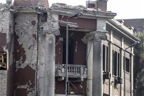 The Italian consulate shows heavy damage following a blast that killed at least one person in Cairo, Egypt, Saturday, July 11, 2015. An Italian embassy official said the consulate was closed at the time of the explosion and no staff members were injured. AP