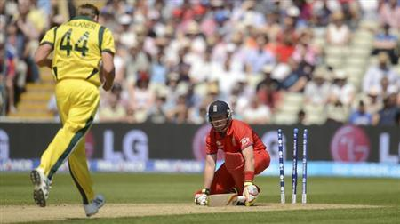 England's Ian Bell is bowled by Australia's James Faulkner (L) during the ICC Champions Trophy group A match at Edgbaston cricket ground, Birmingham June 8, 2013. REUTERS/Philip Brown/Files
