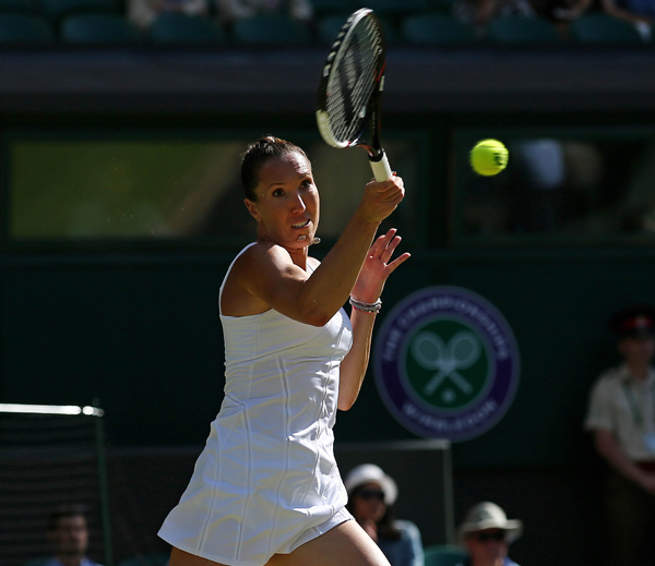 Serbia's Jelena Jankovic returns against Czech Republic's Petra Kvitova during their women's singles third round match of the 2015 Wimbledon Championships at the All England Tennis Club in London on Saturday. Jankovic won the match 3-6, 7-5, 6-4. Photo: AFP
