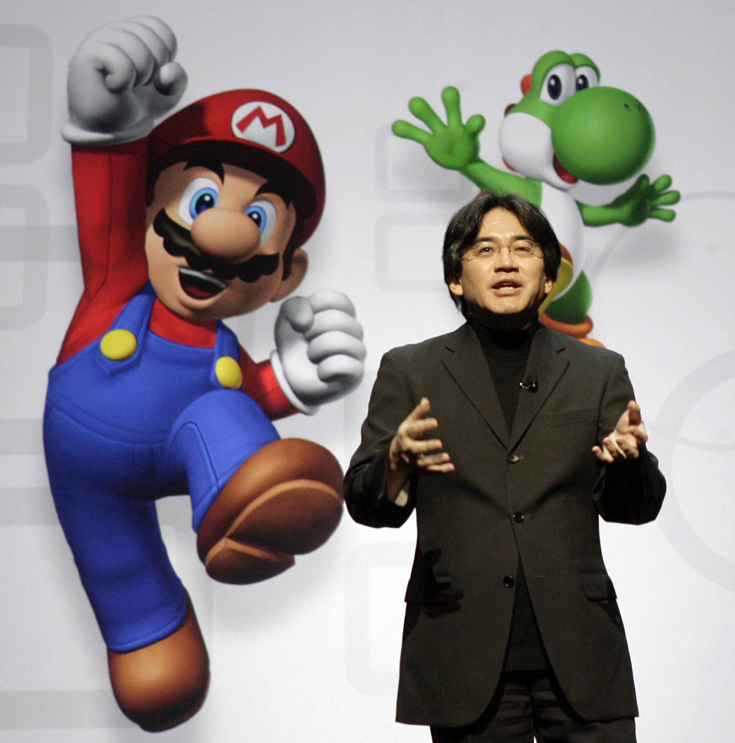 In this July 15, 2008 file photo, Satoru Iwata, President and CEO of Nintendo Co. Ltd., speaks at a news conference where Nintendo unveiled an enhancement for its Wii Remote controller and new games at the E3 Media and Business Summit in Los Angeles.  Nintendo said President Iwata died Saturday, July 11, 2015, of a bile duct tumor in a Kyoto hospital, western Japan. Photo: AP