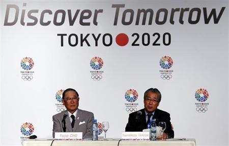 Japan Olympic Committee President Tsunekazu Takeda (R) speaks next to Toyota chairman Fujio Cho during a news conference in support of the Tokyo 2020 summer Olympics candidacy in Buenos Aires September 4, 2013. REUTERS/Marcos Brindicci