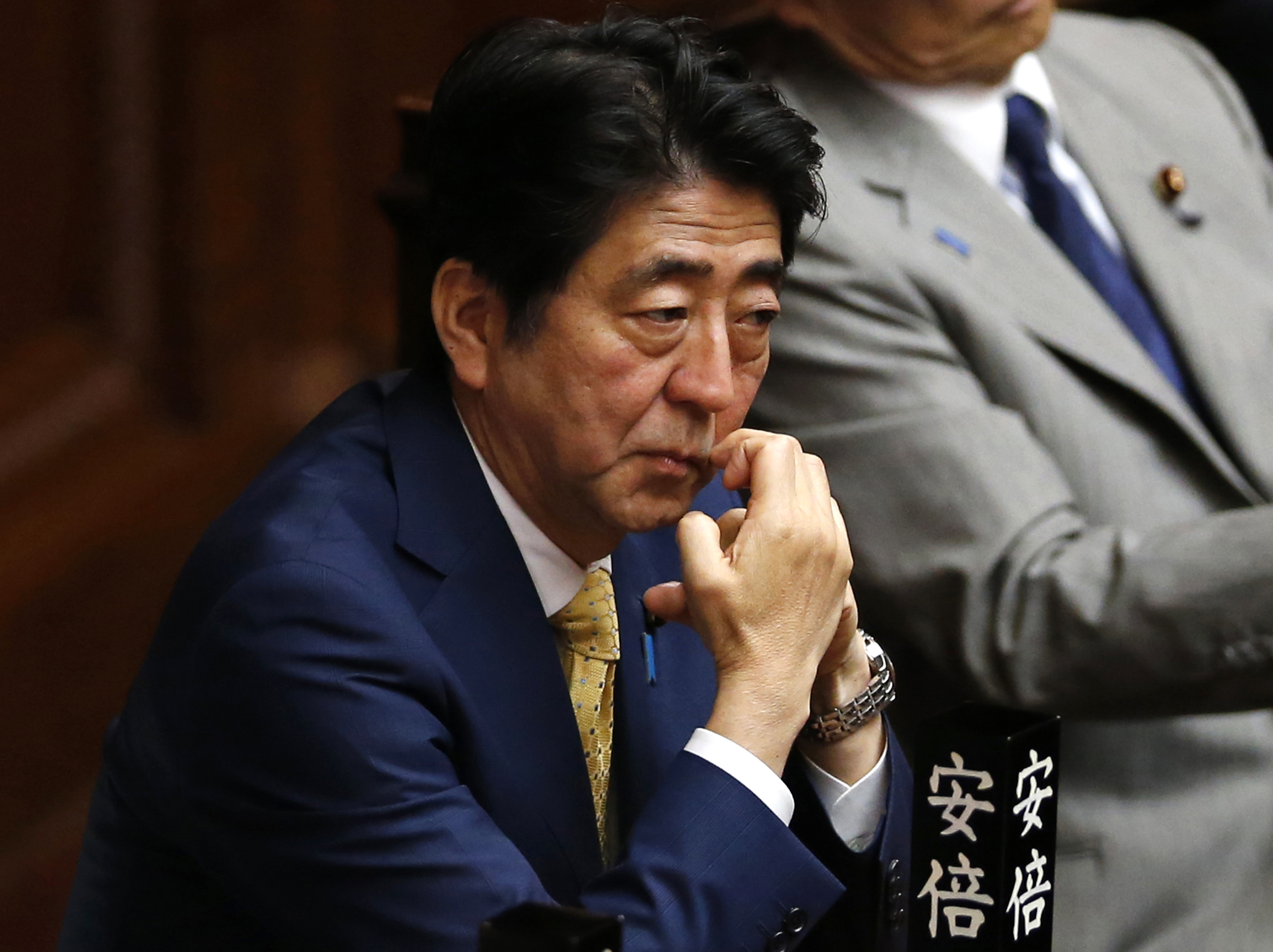 In this July 16, 2015 phpoto, Japanese Prime Minister Shinzo Abe attends a plenary session at the lower house in Tokyo. Public support for Japanese Prime Minister Abe has dropped sharply after his government pushed through highly contentious legislation mid-July to expand the role of the military. Photo: AP