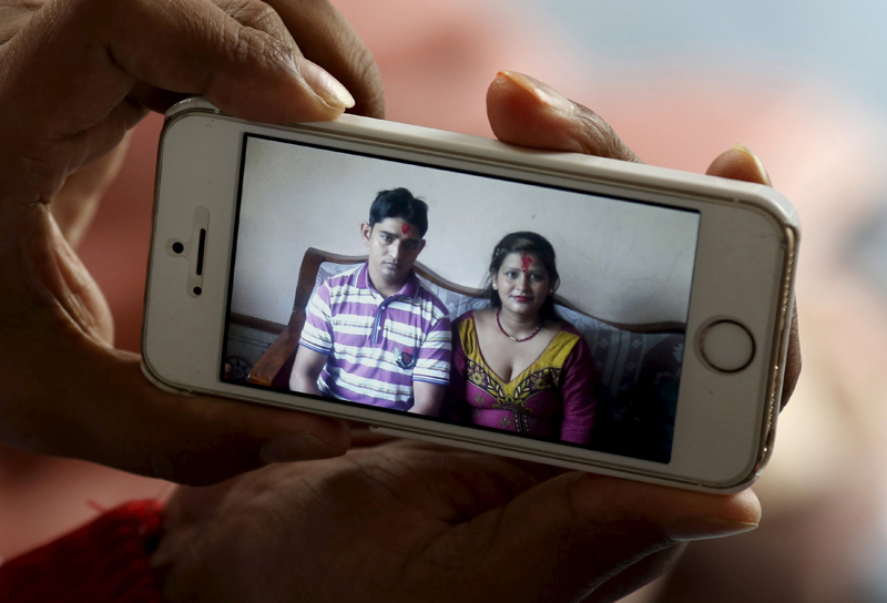 Lakhan Rijal, a 33-year-old Nepali asylum seeker, shows a photograph of himself and his wife in Nepal, during an interview with Reuters at his house in Ota, Gunma prefecture, north of Tokyo, Japan, April 5, 2015. Picture taken April 5, 2015. Photo: Reuters